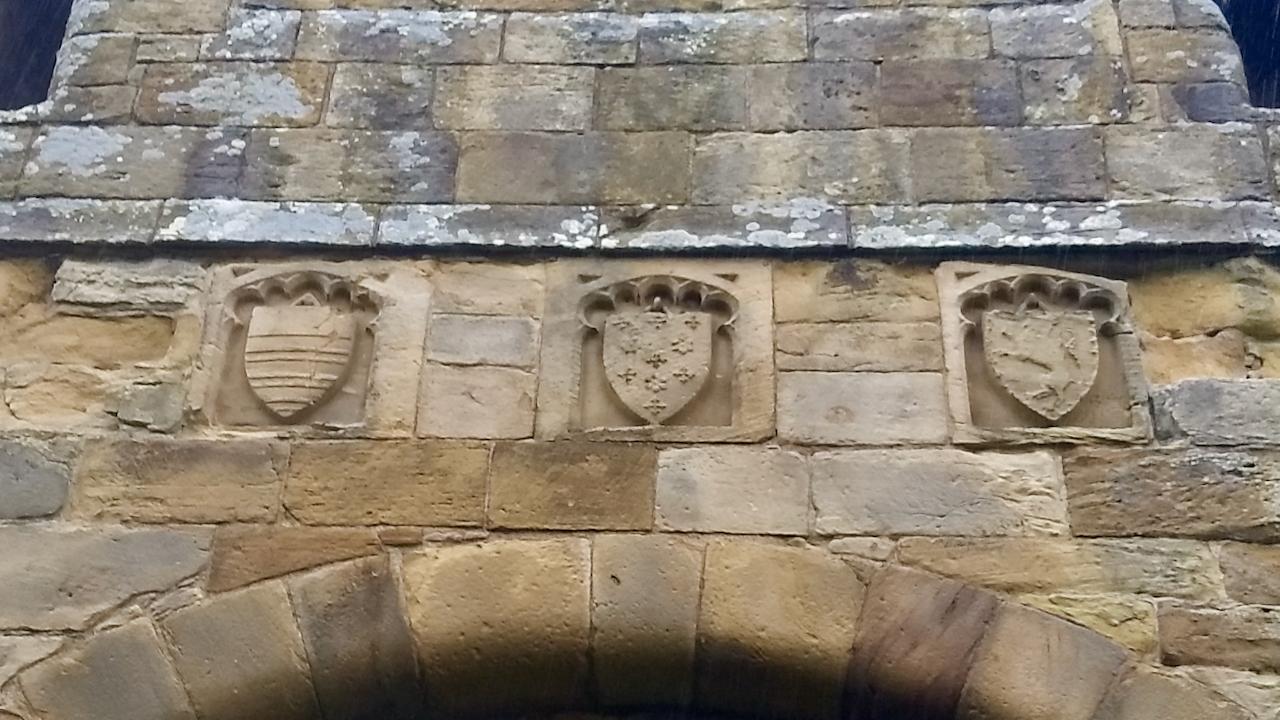 Whorlton Castle, close up of shields above entrance